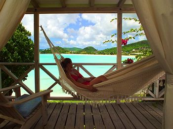 Relaxing in a Hammock on a Shaded Patio at Cocobay Resort in Antigua