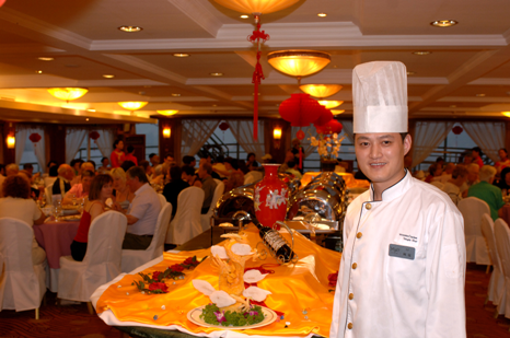 Chef Hosts Dinner Service Onboard Victoria Cruises